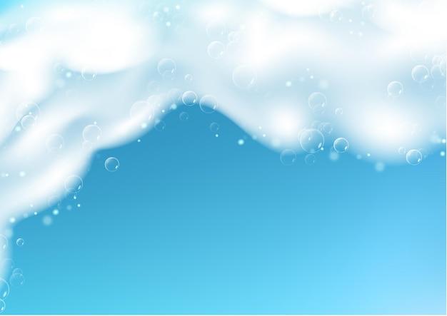 Piękne niebieskie tło z realistyczną pianką mydlaną z bąbelkami