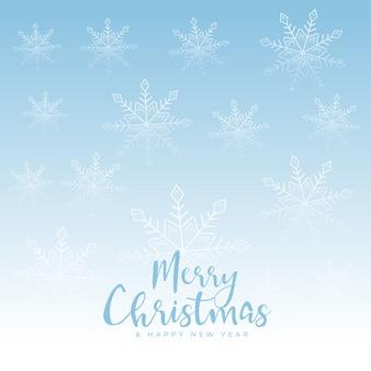 Piękne wesołych świąt bożego narodzenia płatki śniegu niebieskie tło