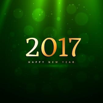 Piękne złote 2017 tekst na zielonym tle z promieni świetlnych