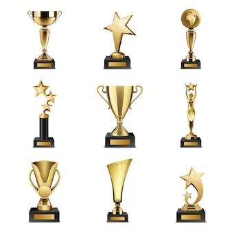 Piękne złote trofeum puchary i nagrody o różnym kształcie realistyczny zestaw na białym tle