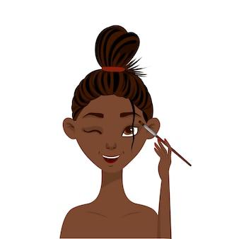 Piękno afrykańska kobieta stosuje cień do powiek.
