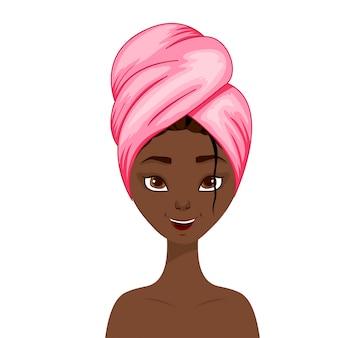 Piękno afrykańska kobieta z ręcznikiem na jej włosy.