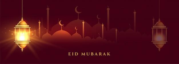 Piękny baner eid mubarak z błyszczącą latarnią islamską