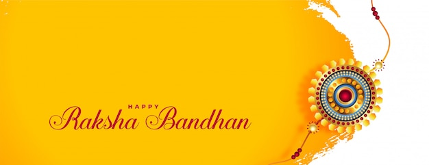 Piękny baner raksha bandhan ze złotym rakhi