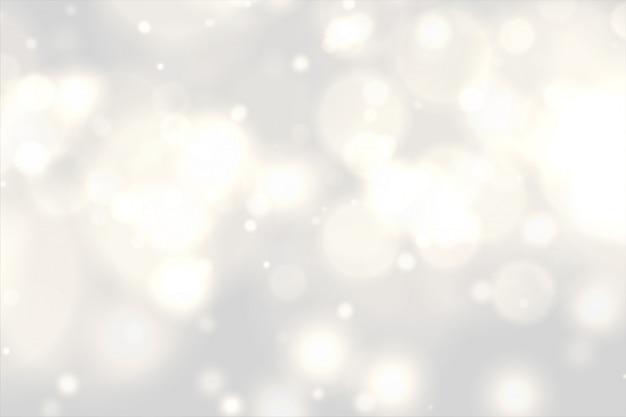 Piękny biały bokeh świateł skutka tło