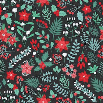 Piękny boże narodzenie kwiatowy wzór z liści ostrokrzewu, jagód i innych zielonych i czerwonych roślin i kwiatów wakacyjnych