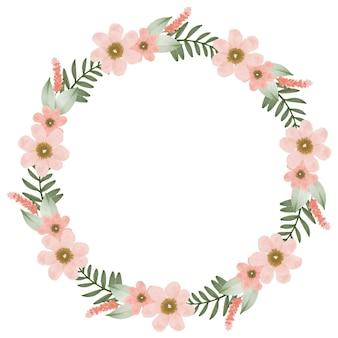 Piękny brzoskwiniowy wieniec koło ramki z brzoskwiniowym kwiatem i zielonym obramowaniem liści