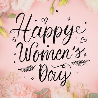 Piękny dzień kobiet napis na tle kwiatów