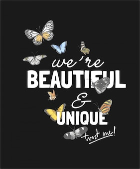 Piękny i niepowtarzalny slogan z kolorowymi motylami na czarnym tle