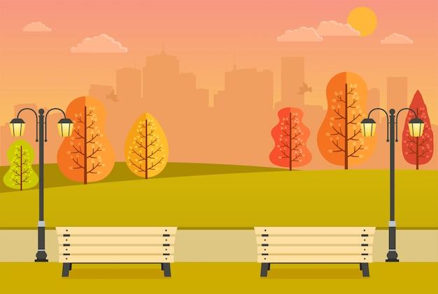 Piękny jesienny park z ławkami, żółtymi i pomarańczowymi drzewami i