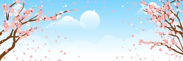 Piękny kwiat sakury (kwiat wiśni) na wiosnę. sakura kwiat na błękitne niebo z rozmyciem światła bokeh.
