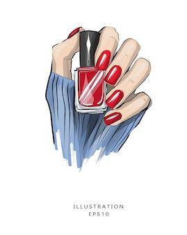 Piękny manicure czerwony lakier do paznokci w dłoni