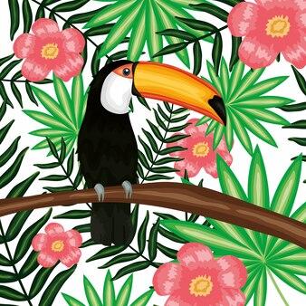 Piękny tukan z dekoracją egzotycznych i tropikalnych kwiatów