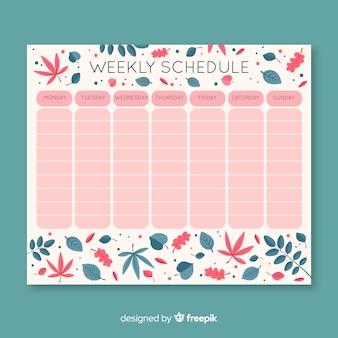 Piękny tygodniowy szablon harmonogramu z kwiatowym stylu