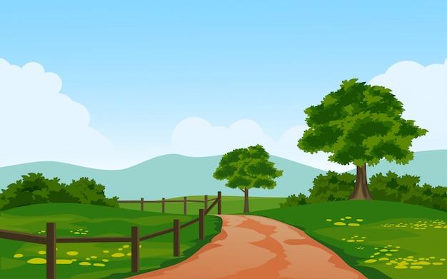 Piękny wiejski krajobraz ze ścieżką i ogrodzeniem