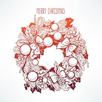 Piękny wieniec bożonarodzeniowy z gałązkami jodły i liśćmi ostrokrzewu