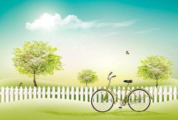 Piękny wiosny natury tło z kwitnie drzewami i ogrodnikiem.