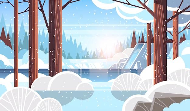 Piękny wodospad nad skalistym klifem śnieżny zimowy las natura pejzaż
