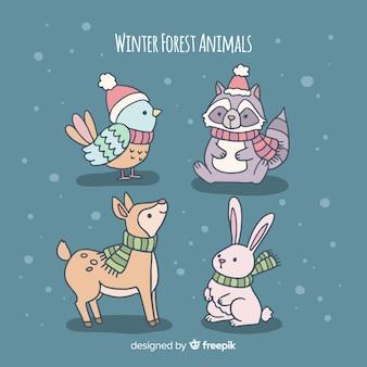Piękny zestaw ręcznie rysowane zwierzęta zimowe