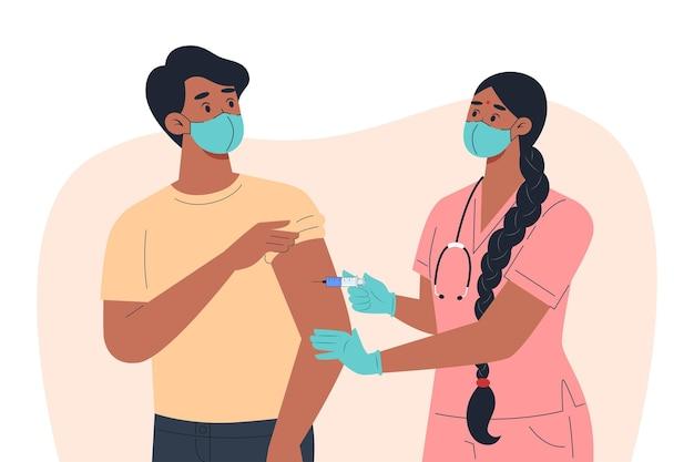 Pielęgniarka w masce i rękawiczkach robi szczepionkę pacjentowi płci męskiej
