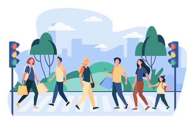 Piesi przechodzący przez ulicę. ludzie przez jezdnię na światłach. ilustracja wektorowa dla przejścia dla pieszych, bezpieczeństwa na drogach, obywateli