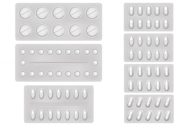 Pigułki medyczne. medyczne środki przeciwbólowe, antybiotyki, witaminy i tabletki aspiryny. zestaw realistyczne ikony białe pęcherze z pigułek i kapsułek.