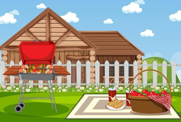 Piknik z jedzeniem na stole i grillem w ogrodzie