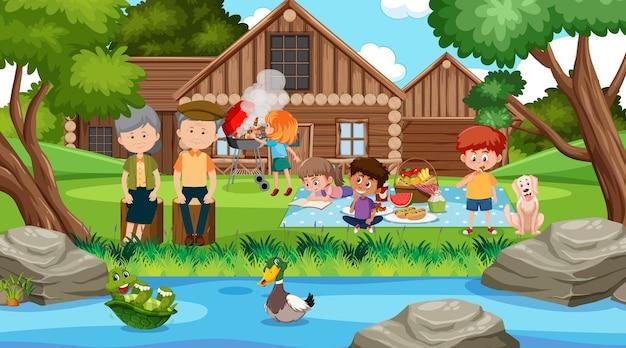 Piknikowa scena z szczęśliwą rodziną w ogrodzie