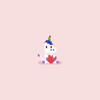 Piksel siedzi jednorożec przytulanie czerwone serce