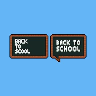"""Pikselowa czarna tablica z tekstem """"powrót do szkoły""""."""