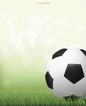 Piłka nożna piłka na polu zielona trawa z światło niewyraźne tło bokeh. ilustracja wektorowa.