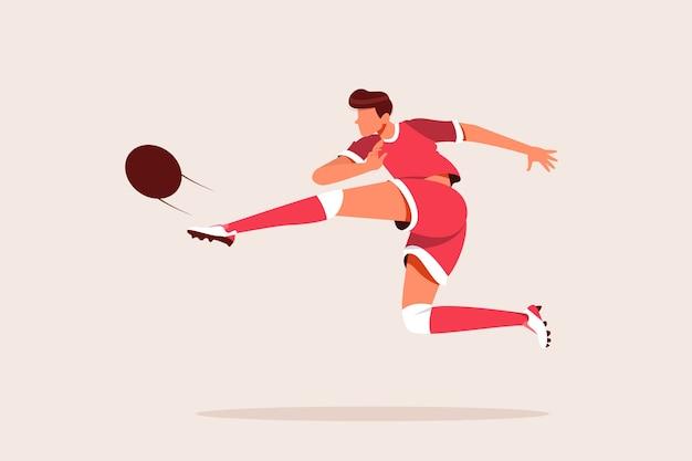 Piłkarz kopiąc piłkę do bramki