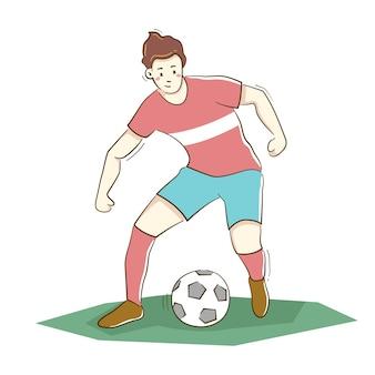 Piłkarz kopie piłkę na białym tle