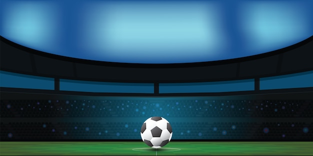 Piłki nożnej piłka na zielonym stadium w nocy.