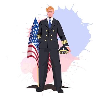 Pilot w mundurze trzymając flagę usa szczęśliwy dzień pracy