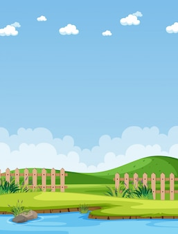 Pionowa scena przyrody lub krajobraz wsi z częścią widoku gospodarstwa i puste niebo w ciągu dnia