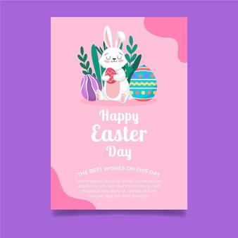 Pionowy szablon kartki z życzeniami na wielkanoc z królikiem i jajkami