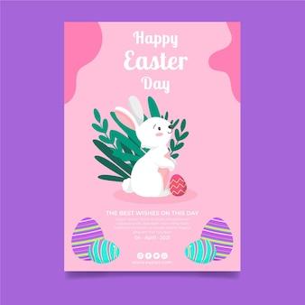 Pionowy szablon plakatu na wielkanoc z zajączkiem i jajkami