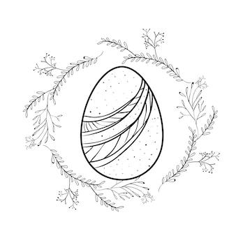 Pisanka z ozdobnymi liniami i gałęziami wokół