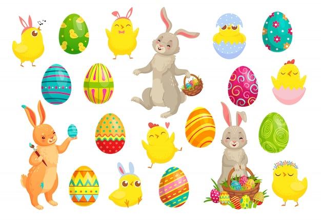 Pisanki, śliczny królik, wiosenne pisklęta i kolorowy zestaw jajek