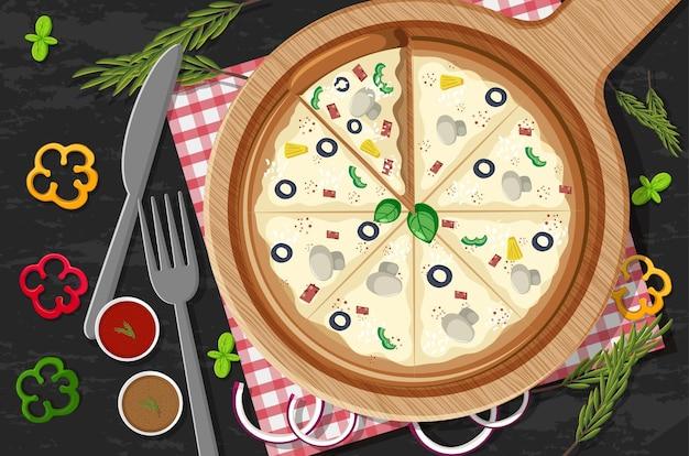 Pizza na drewnianym talerzu z różnymi warzywami na tle stołu