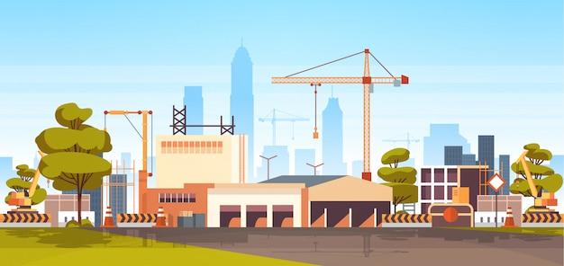 Plac budowy z dźwigami wieżowymi
