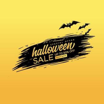 Plac sprzedaży halloween z napisem na czarnym pędzlem.