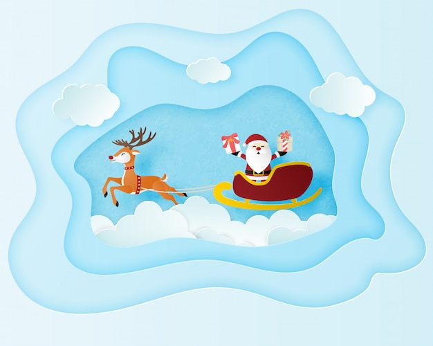 Plakat celebracja bożego narodzenia w stylu cięcia papieru. grafika papierowa sprawiła, że święty mikołaj i renifery latają nad cloudscape.