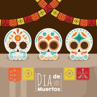 Plakat dia de los muertos z głowami, czaszkami i girlandami