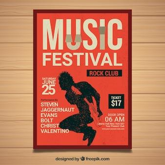 Plakat festiwalu z osobą grającą