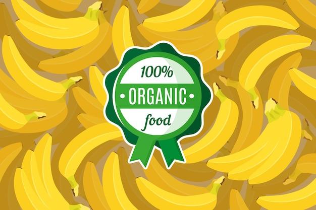 Plakat lub baner z ilustracją żółtego tła tropikalnych bananów i okrągłą zieloną etykietą żywności ekologicznej