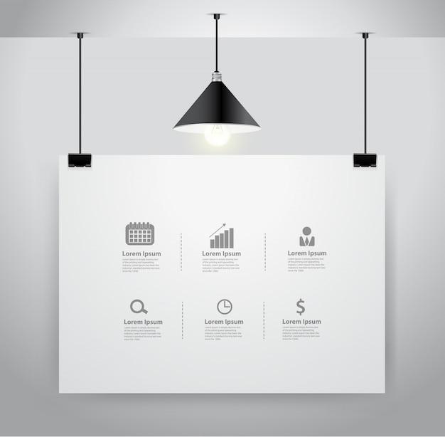 Plakat makiety na ścianie i lampie