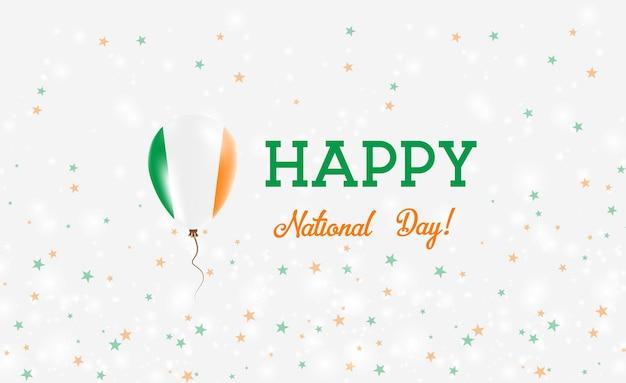 Plakat patriotyczny święto narodowe irlandii. latający balon gumowy w kolorach flagi irlandii. tło święto narodowe irlandii z balonem, konfetti, gwiazdy, bokeh i błyszczy.