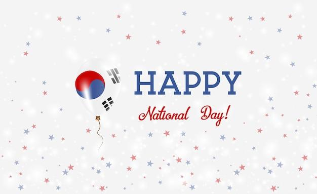 Plakat patriotyczny święto narodowe korei południowej. latający balon gumowy w kolorach flagi korei południowej. tło święto narodowe korei południowej z balonem, konfetti, gwiazdy, bokeh i błyszczy.